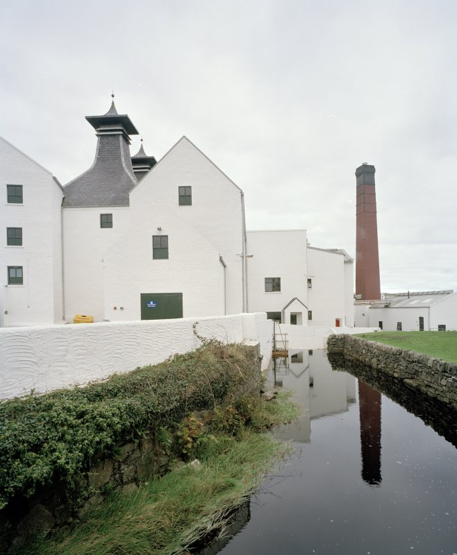 Lagavulin Distillery Detailed view of distillery from W, with lade in foreground and kilns, still house and boilerhouse chimney in background