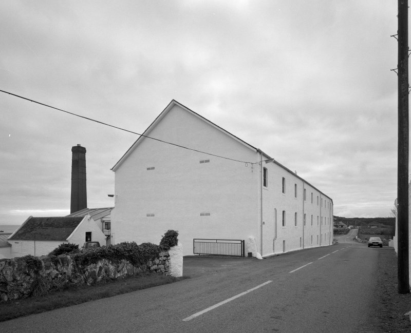 Lagavulin Distillery View from NE of range of former floor-maltings, with boilerhouse chimney visible (distant left)
