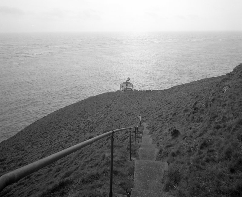 View from NE, looking down steep path and steps from lighthouse to fog horn.