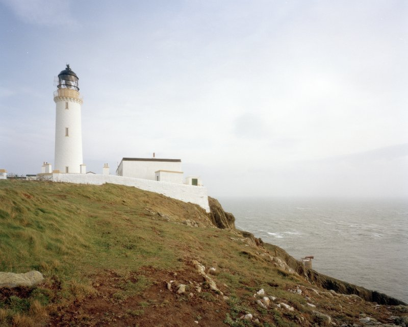 General view of lighthouse compound from SW, showing cliff-top location, and the position of the foghorn on the cliffs below.