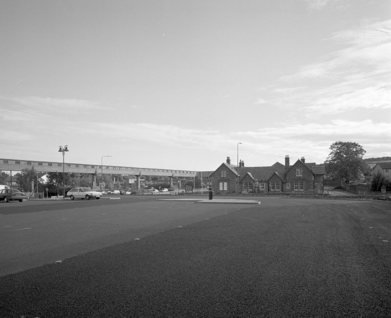 Newtongrange, Lady Victoria Colliery, Lothian Coal Company Offices (former SMM Visitor Centre) View from south west looking across recently constructed car park towards the colliery overhead walkway (over the A7 trunk road), and (right) the former offices of the colliery's founder, the Lothian Coal Company
