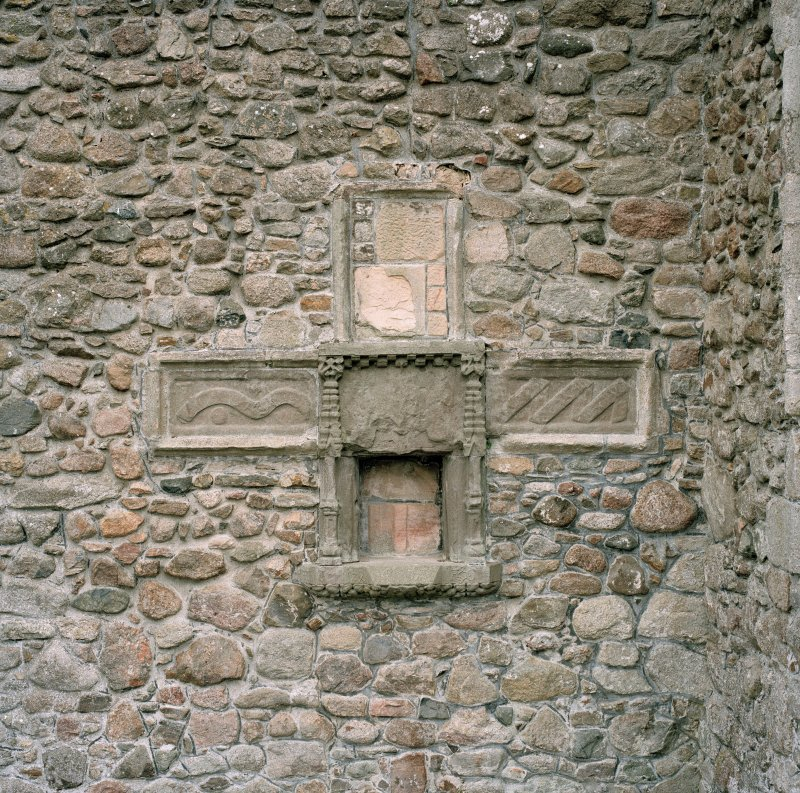 Detail of cruciform in wall of sacrament house.