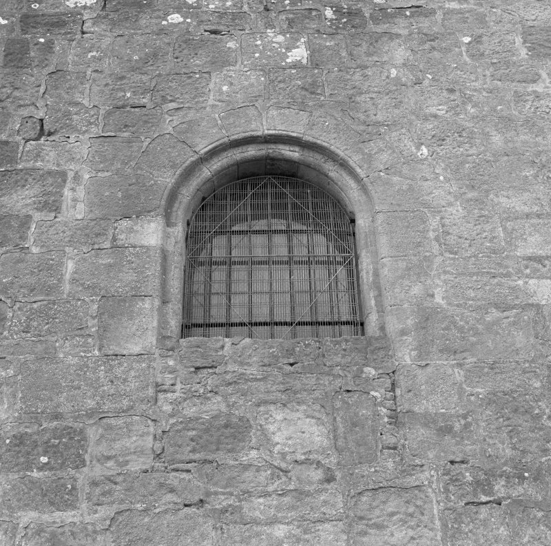Tower, detail of East window former roll molded first floor entrance