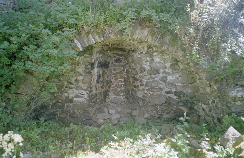Detail of vault and blocked window at foot of SE wall