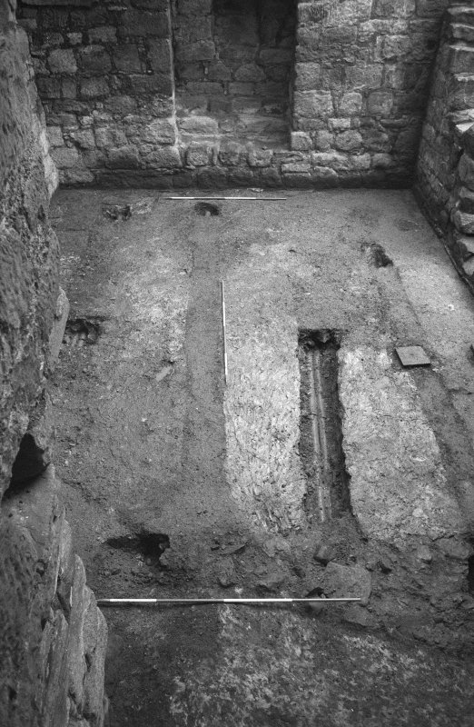 Excavation photograph : floor of basement after partial excavation of some of modern drains, from N.