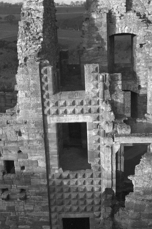 Excavation photograph : Italianate facade extending into the N end of west range, from E.