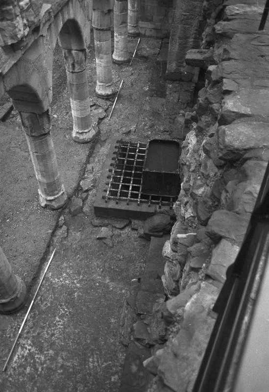 Excavation photograph : area between S wall of N range and columns supporting Italianate facade; rebuilt well, centre frame.