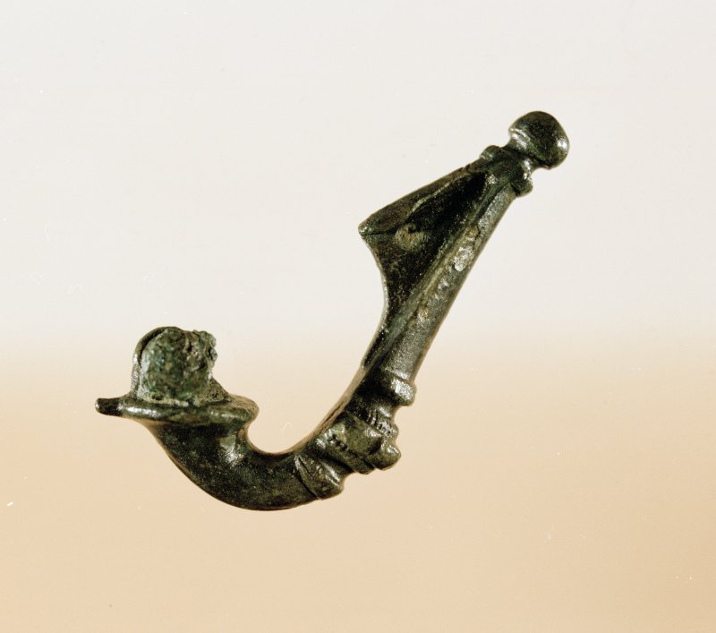 Post excavation photograph : trumpet brooch found during excavation (sf133).