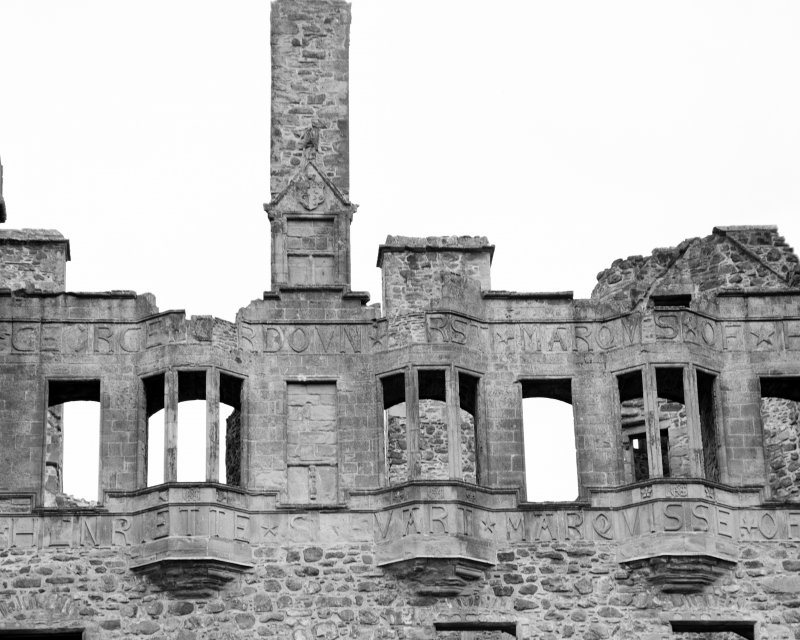View of upper windows and inscription on South facade of Huntly Castle.