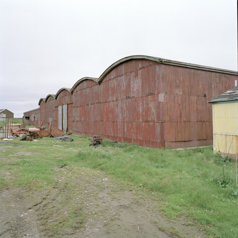 View from S of workshops showing curved roofed sheds.