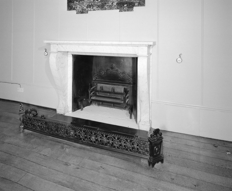 Entrance hall detail of fireplace