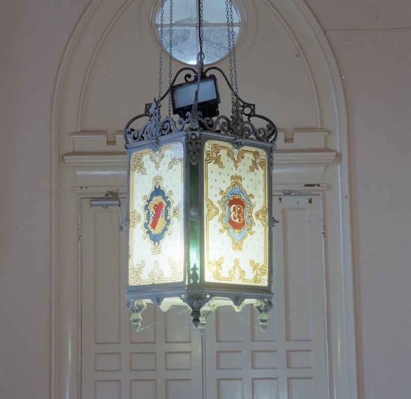 Entrance porch, detail of light fitting with the initials and the coat of arms of the 11th Lord Blantyre
