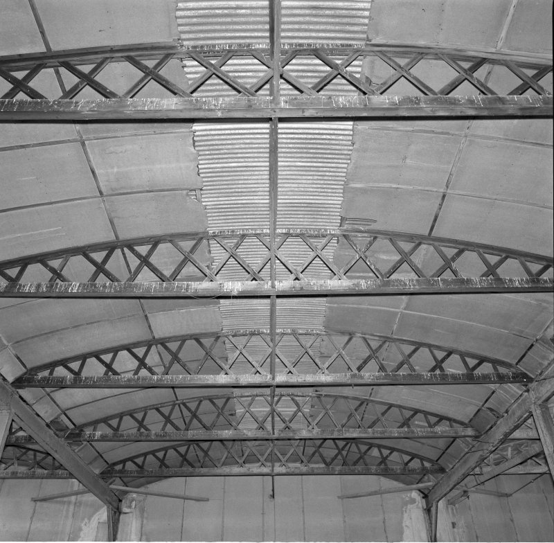 Interior view of workshops showing detail of wooden roof trusses