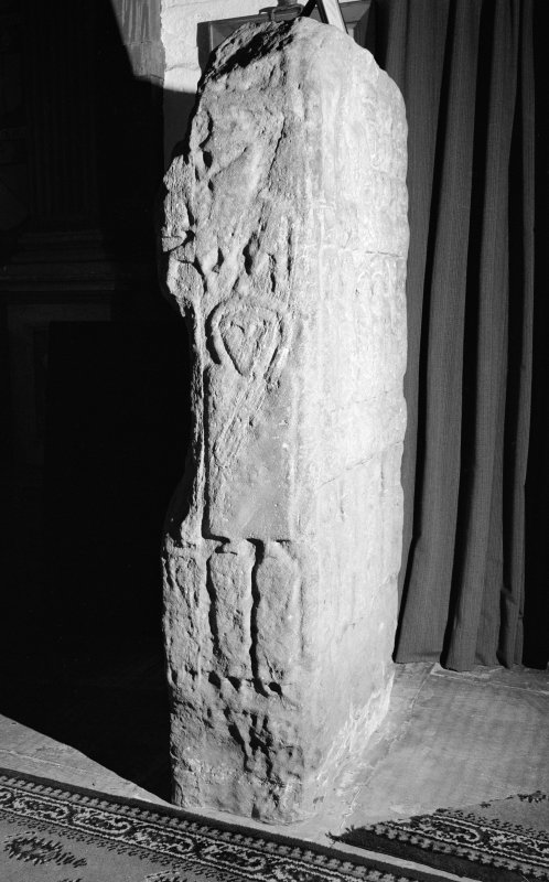 View of side of the Apostles Stone cross slab on display in Dunkeld Cathedral.