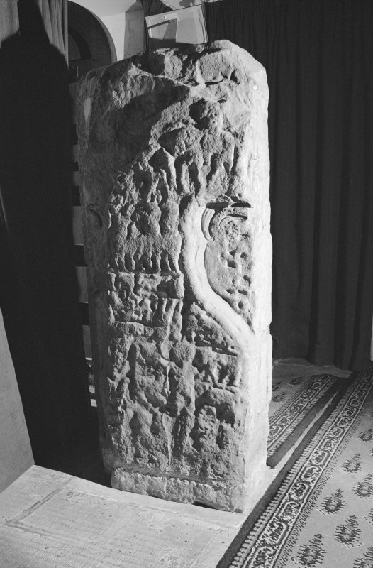 View of face of the Apostles Stone cross slab on display in Dunkeld Cathedral.