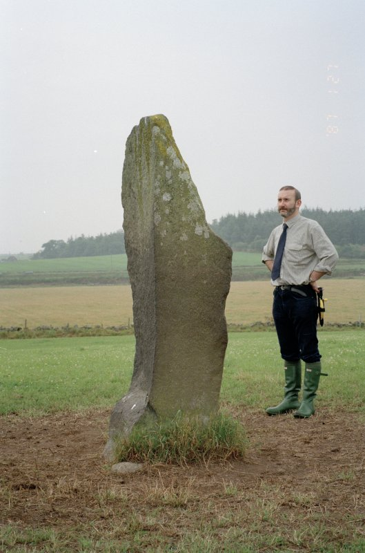 View of rubbing stone from SW, with Dr Iain Fraser (RCAHMS) in picture
