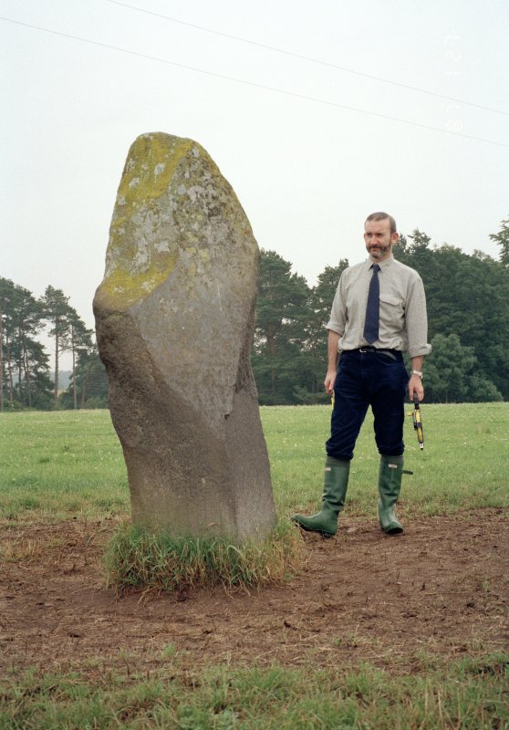 View of rubbing stone from NE, with Dr Iain Fraser (RCAHMS) in picture