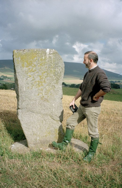 View of Craw Stane from SW; Dr Ian Fraser (RCAHMS) in picture