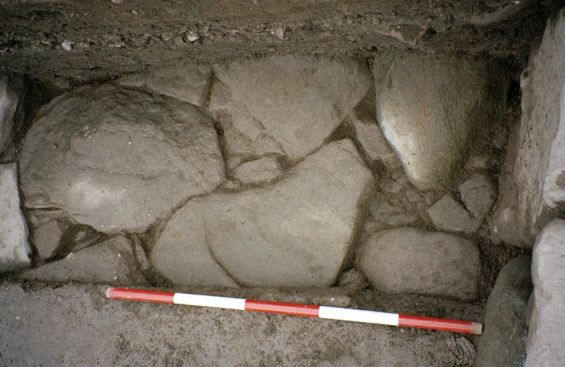 Detail of paving at NE corner of the excavation trench. Scale in 200mm divisions