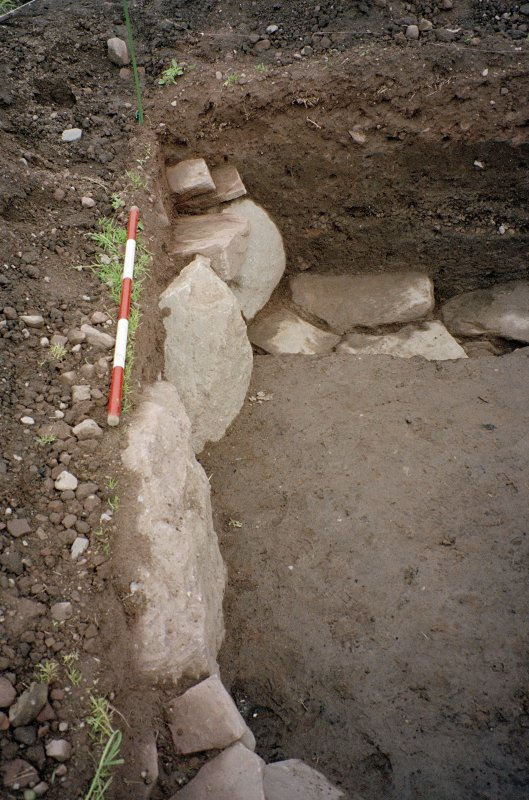 View of the W side of the excavation trench. Scale in 200mm divisions
