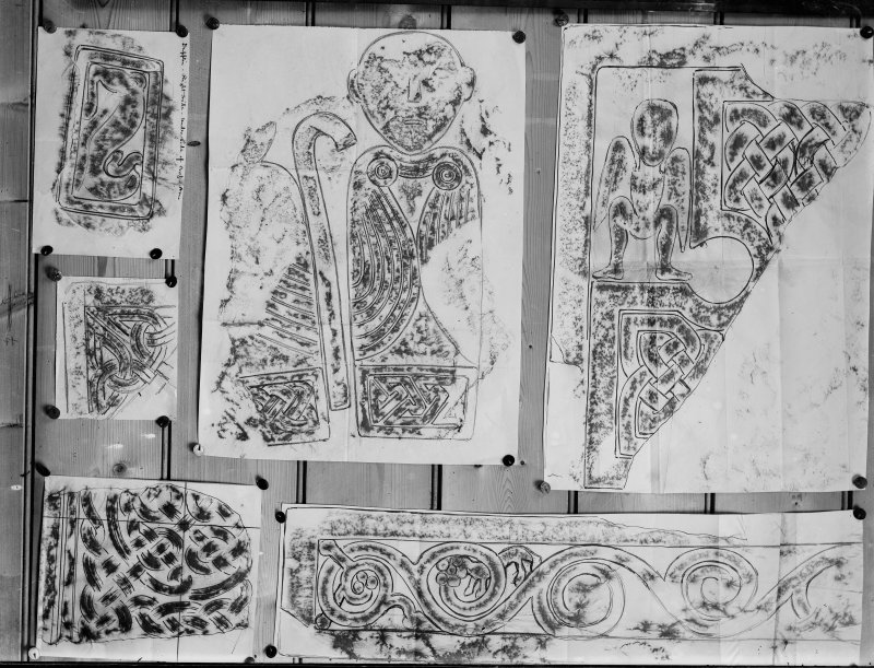Photographic copy of six rubbings.  The upper left rubbing shows detail from panel of the Dupplin Cross; the upper central rubbing shows detail of face of Meigle no. 29 Pictish cross slab fragment and the upper and bottom right rubbings show details of the Drosten Stone Pictish cross slab, St Vigeans no.1. The left middle and bottom rubbings are yet to be identified.