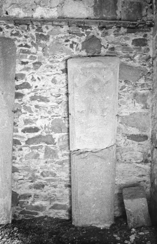 View of fragmented graveslab in Lamont Aisle at Kilfinan Churchyard.