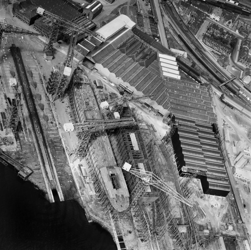 John Brown and Co, Shipyard, Clydebank, Old Kilpatrick, Dunbartonshire, Scotland, 1949. Oblique aerial photograph taken facing north.