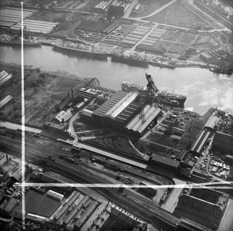 Barclay, Curle and Co, Ltd, north British Diesel Engine Works,  Whiteinch, Govan, Lanarkshire, Scotland, 1950. Oblique aerial photograph taken facing south.  This image has been produced from a crop marked negative.