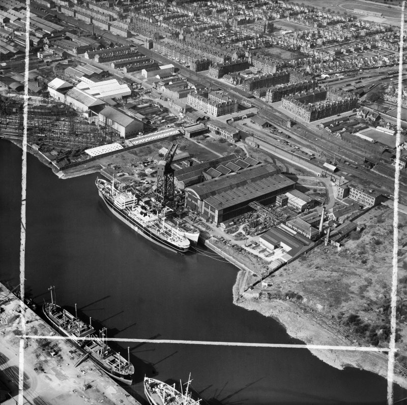 Barclay, Curle and Co, Ltd, north British Diesel Engine Works,  Whiteinch, Govan, Lanarkshire, Scotland, 1950. Oblique aerial photograph taken facing north.  This image has been produced from a crop marked negative.