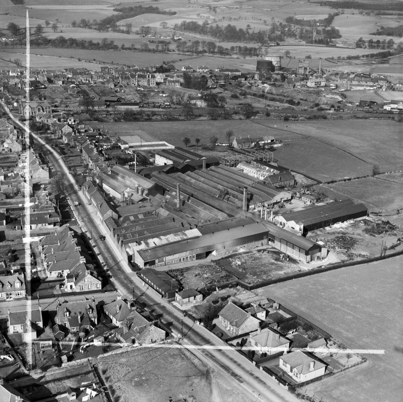 Cruikshank and Co, Ltd, Denny Iron Works, Mydub, Denny, Stirlingshire, Scotland, 1950. Oblique aerial photograph taken facing north.  This image has been produced from a crop marked negative.