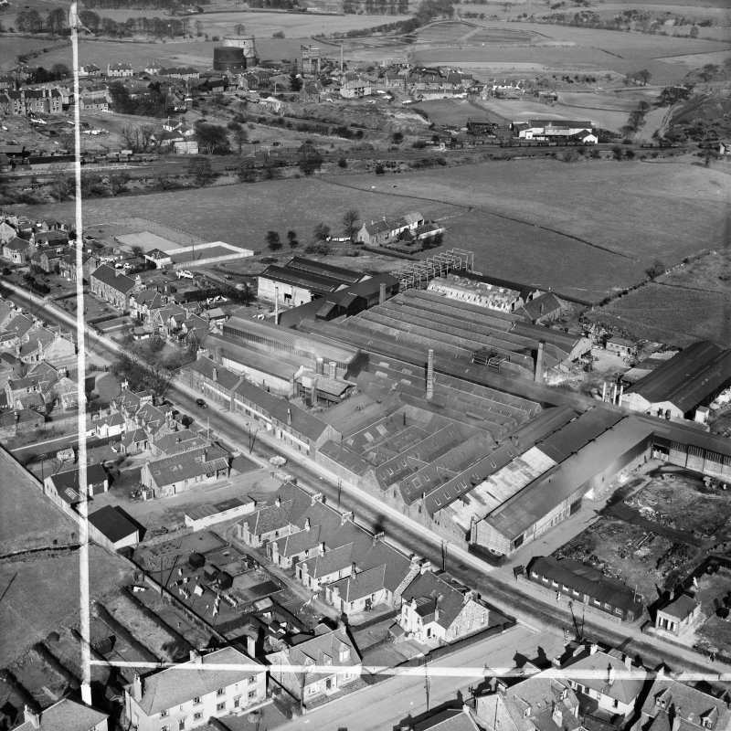 Cruikshank and Co, Ltd, Denny Iron Works, Mydub, Denny, Stirlingshire, Scotland, 1950. Oblique aerial photograph taken facing north-east.  This image has been produced from a crop marked negative.