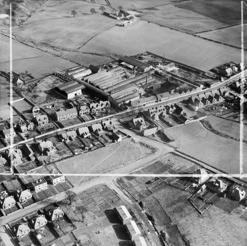 Cruikshank and Co, Ltd, Denny Iron Works, Mydub, Denny, Stirlingshire, Scotland, 1950. Oblique aerial photograph taken facing south-east.  This image has been produced from a crop marked negative.