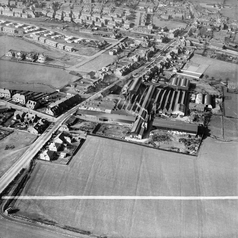 Denny, general view, showing Cruikshank and Co, Ltd, Denny Iron Works, Glasgow Road and Paris Avenue,   Mydub, Denny, Stirlingshire, Scotland, 1950. Oblique aerial photograph taken facing north.  This image has been produced from a crop marked negative.