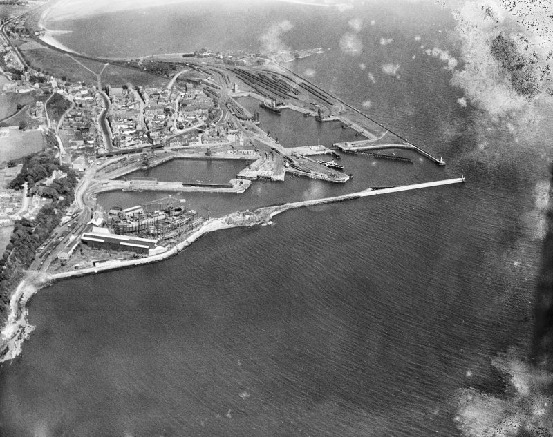 Burntisland Harbour, Burntisland, Fife, Scotland, 1929.  Oblique aerial photograph taken facing east.  This image has been produced from a damaged negative.