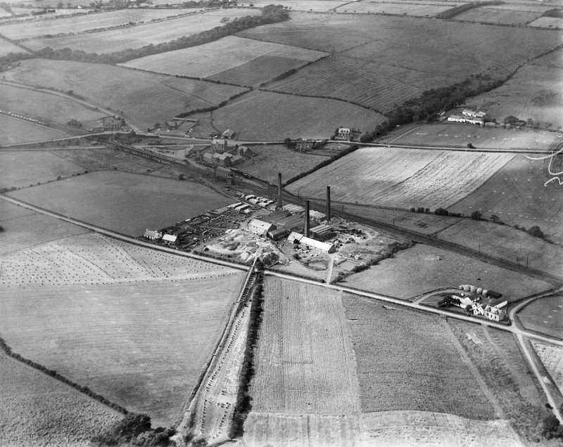 Glenboig Union Fireclay Co. Cumbernauld Fireclay Works, Cumbernauld, Dunbartonshire, Scotland, 1930.  Oblique aerial photograph taken facing north-east.