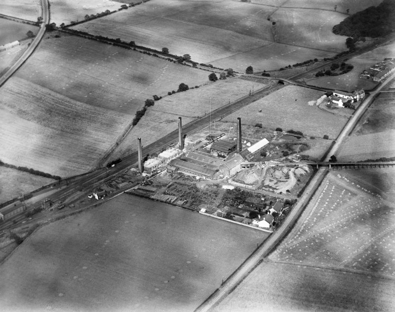 Glenboig Union Fireclay Co. Cumbernauld Fireclay Works, Cumbernauld, Dunbartonshire, Scotland, 1930.  Oblique aerial photograph taken facing east.