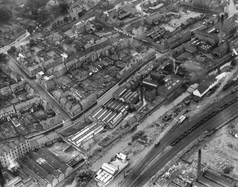 General view, showing Peter Anderson Ltd. Bridge Mill, Huddersfield Street and Gala Water, Galashiels, Selkirkshire, Scotland, 1939.  Oblique aerial photograph taken facing west.