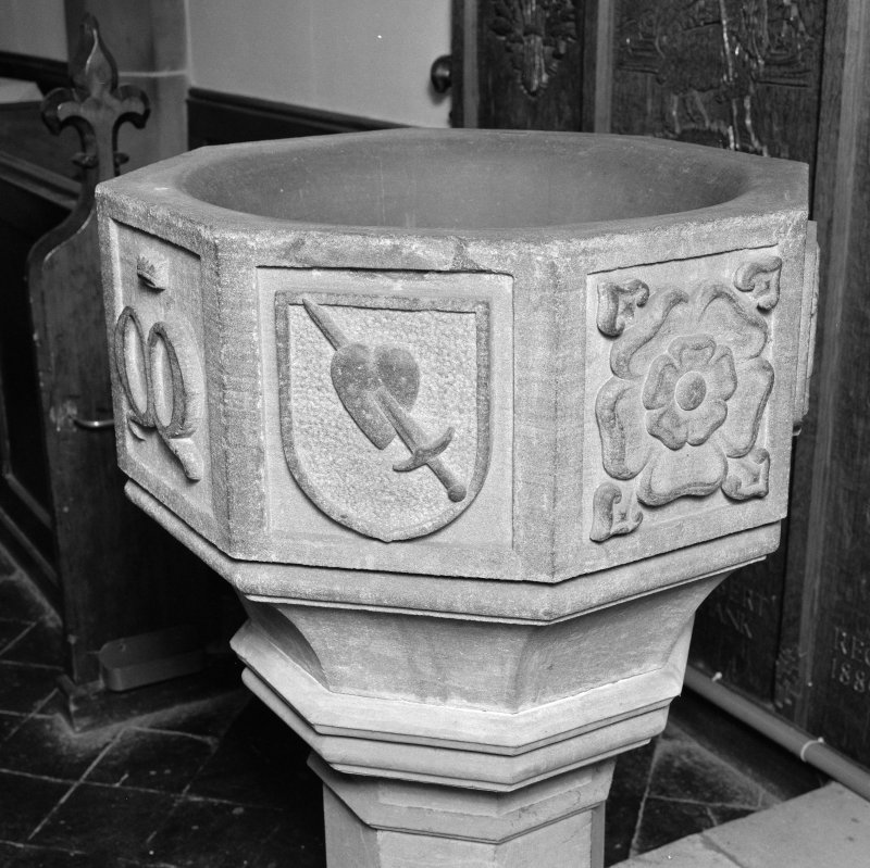 Font from Kinkell Old Parish Church now in St John's Episcopal Church, Aberdeen. Detail of panels bearing a) shield charged with the heart pierced by a sword, and b) a rose.