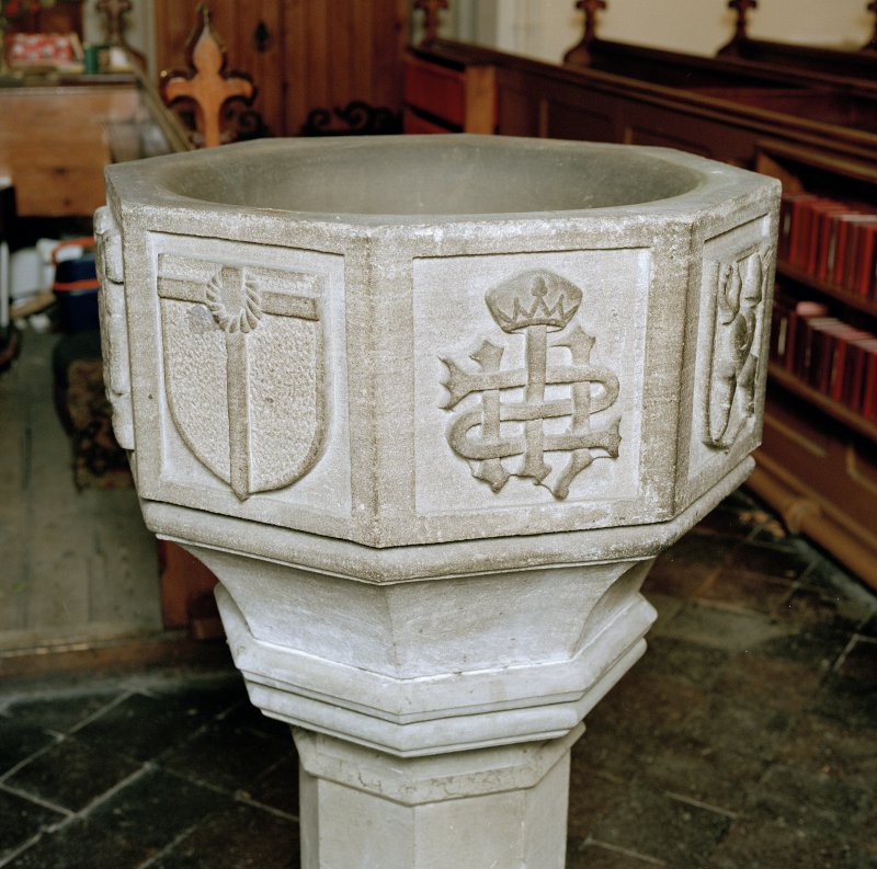 Font from Kinkell Old Parish Church now in St John's Episcopal Church, Aberdeen. Detail of panels displaying a) shield charged with the Crown of Thorns suspended from the Cross, and b) the crowned monogram IHS.