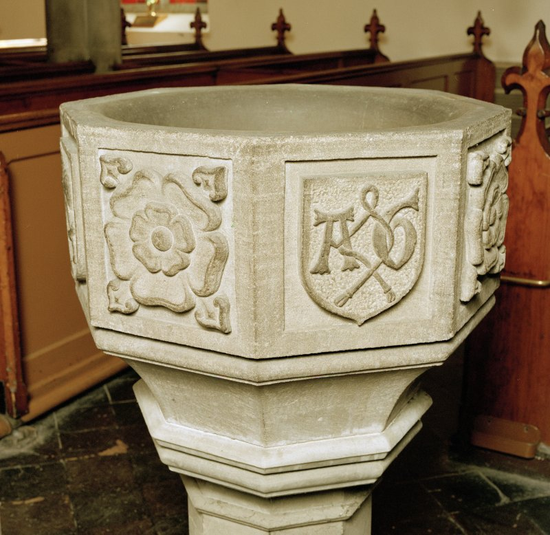 Font from Kinkell Old Parish Church now in St John's Episcopal Church, Aberdeen. Detail of panels displaying a) a rose, and b) a shield bearing the linked initials AG, for Alexander Galloway.