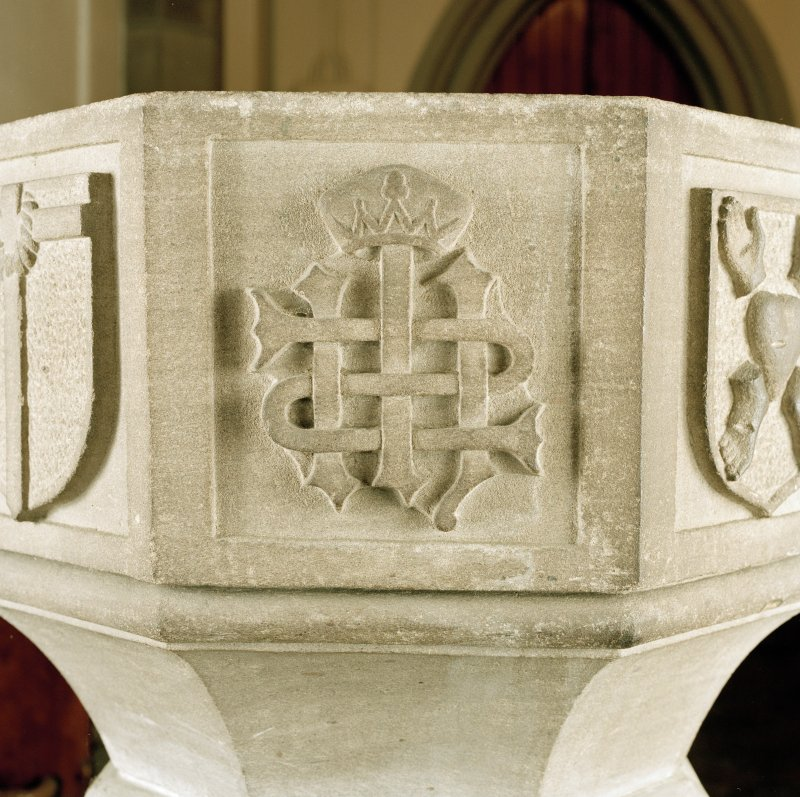 Font from Kinkell Old Parish Church now in St John's Episcopal Church, Aberdeen. Detail of panel bearing the crowned monogram IHS.