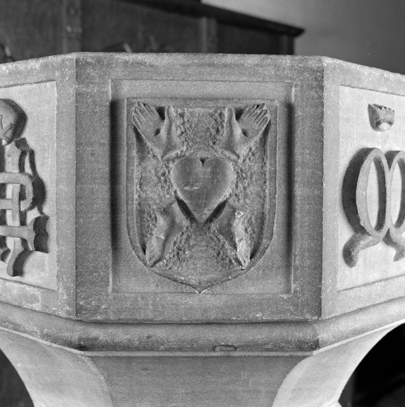 Font from Kinkell Old Parish Church now in St John's Episcopal Church, Aberdeen. Detail of panel bearing a shield charged with the Five Wounds.