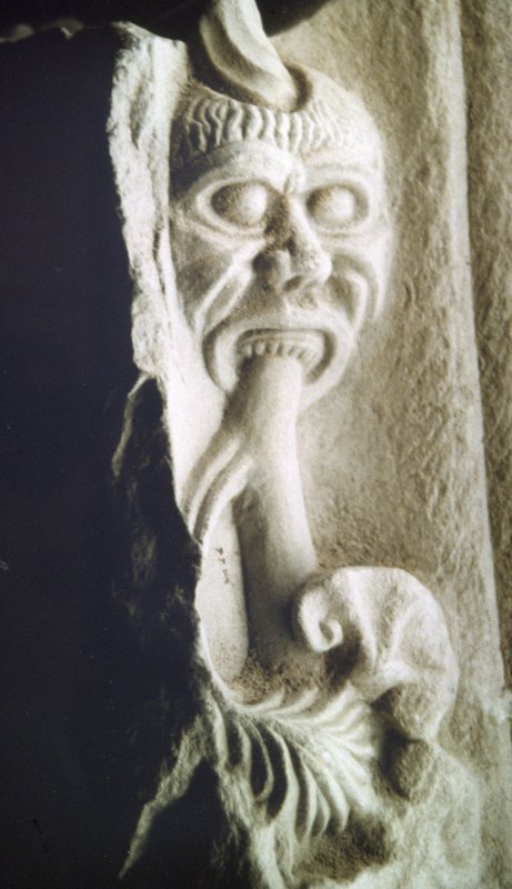 Detail of carved headstone showing Green Man, St Andrews Cathedral Museum.