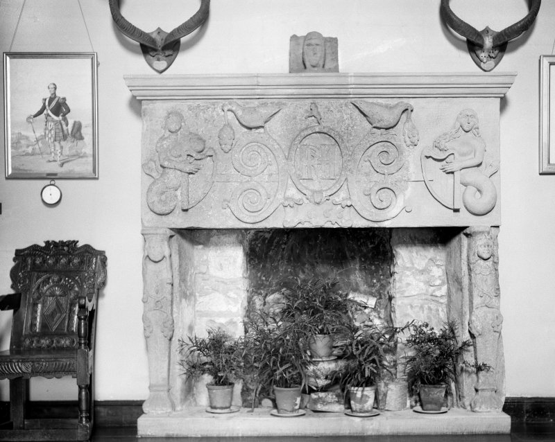 Kilravock Castle. Reconstructed fireplace in front hall and finial, perhaps from tomb effigy.