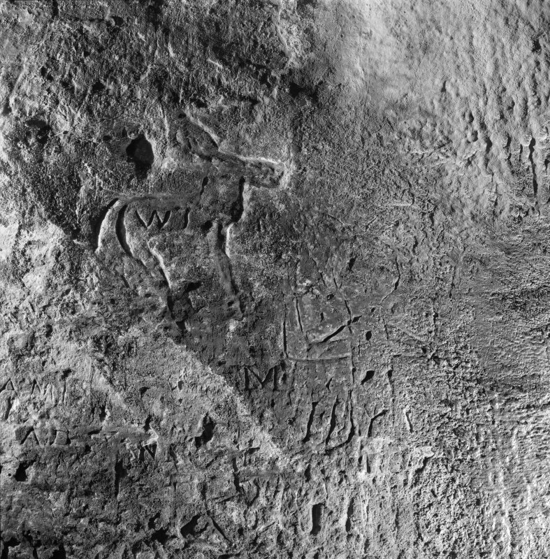 Incised human figure on SW wall, King's Cave, Arran.