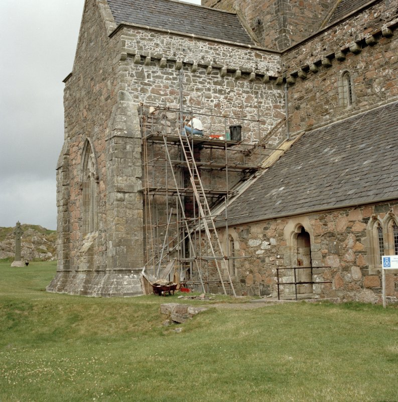 External view from the SE of the N transept of the Iona Abbey church, showing repairs in progress.