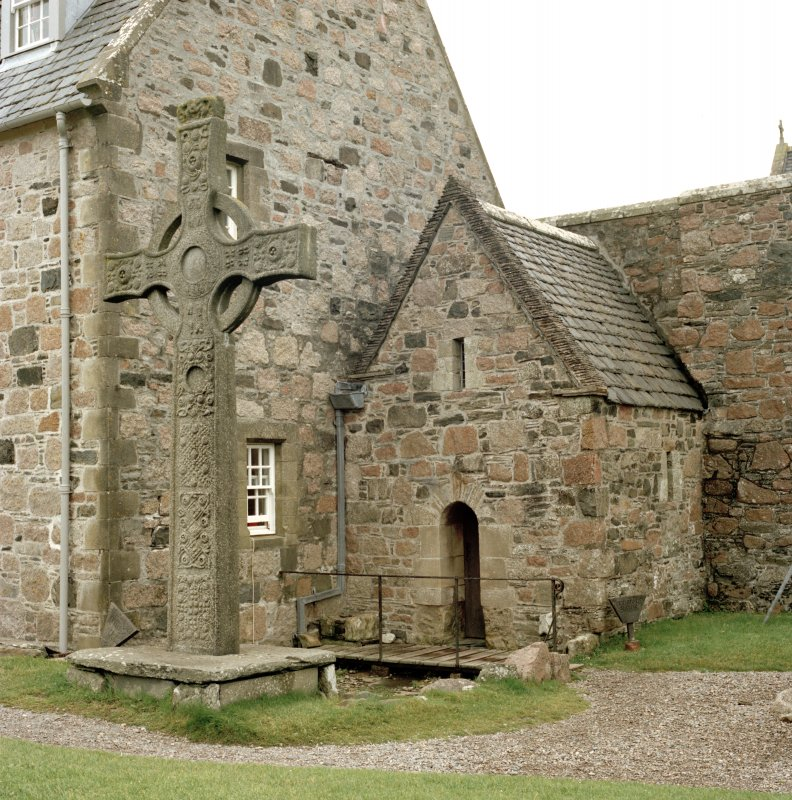 View of the replica St John's Cross in the original base in front of St Columba's Shrine, Iona Abbey.