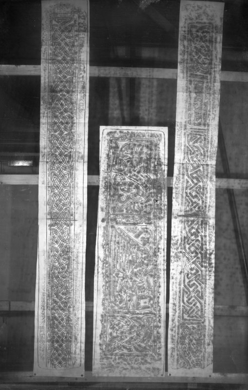 Photographic copy of three rubbings.The central rubbing shows panel details from the Dupplin Cross. The left and right rubbings show interlace details from the sides of St Andrews no.14 cross shaft.