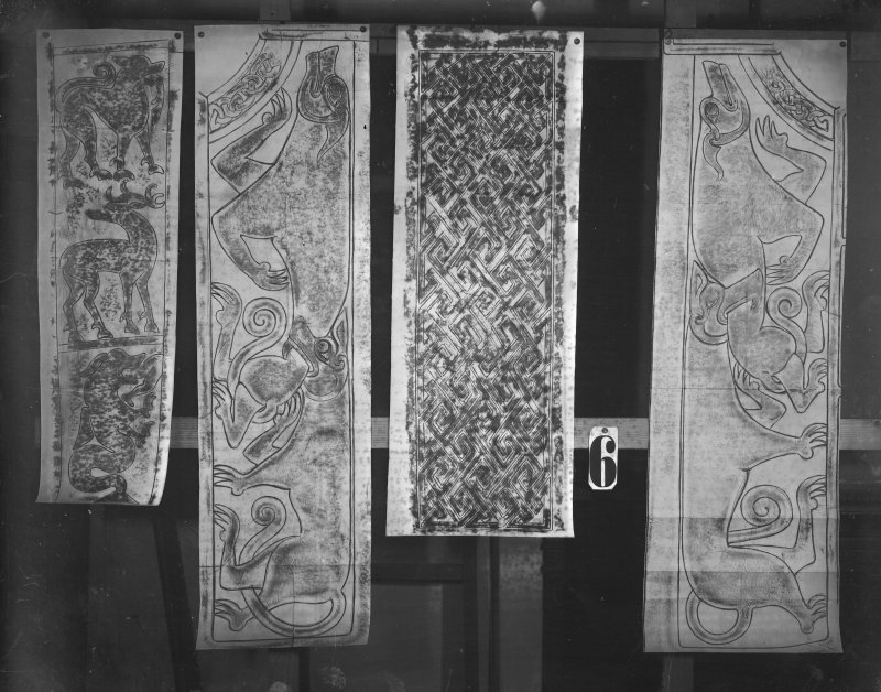Photographic copy of four rubbings. The right and middle-left rubbings depict sections from the face of St Madoes  Pictish cross slab. The left rubbing shows the left side of the face of Dunfallandy Pictish cross slab. The middle-right rubbing is unidentified.