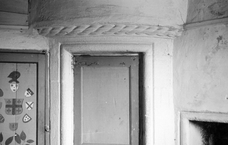 Gardyne Castle. Interior. Detail of cable moulding over door of turret.